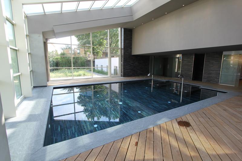 Ampliamento villa con piscina coperta arkiten for Piani di piscina coperta